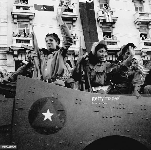 1/59 Women Cuban rebel soldiers waving from tank upon arrival in Havana Cuba