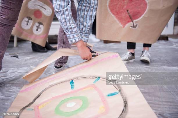 Women cutting loose their art work