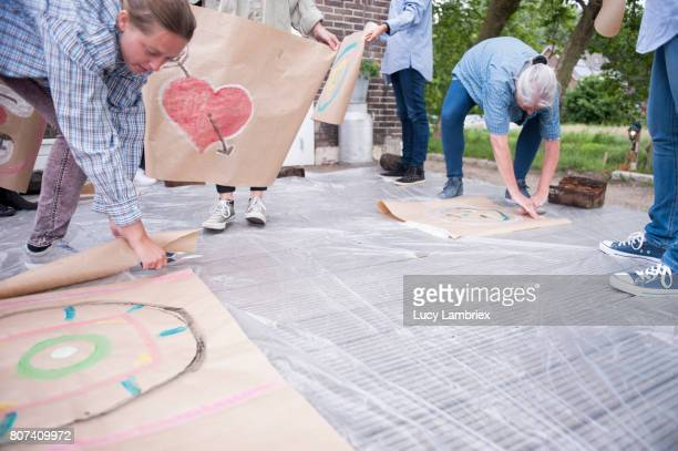 Women cutting loose their art work