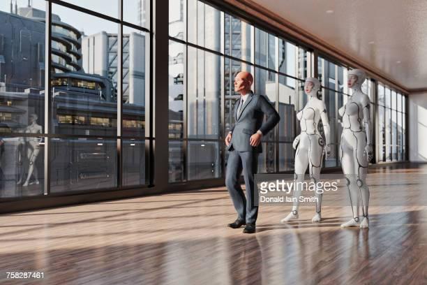 Women cyborgs following businessman