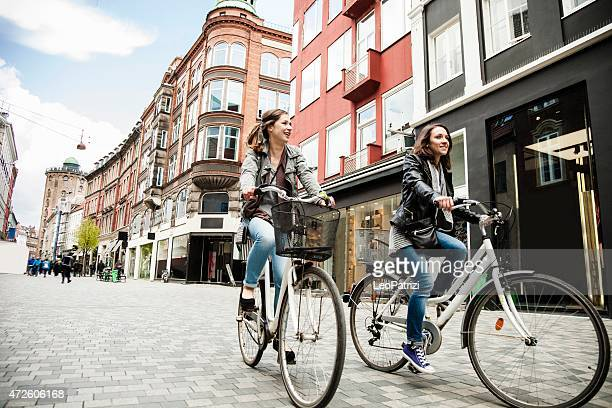 women cycling in copenhagen - copenhagen stock pictures, royalty-free photos & images
