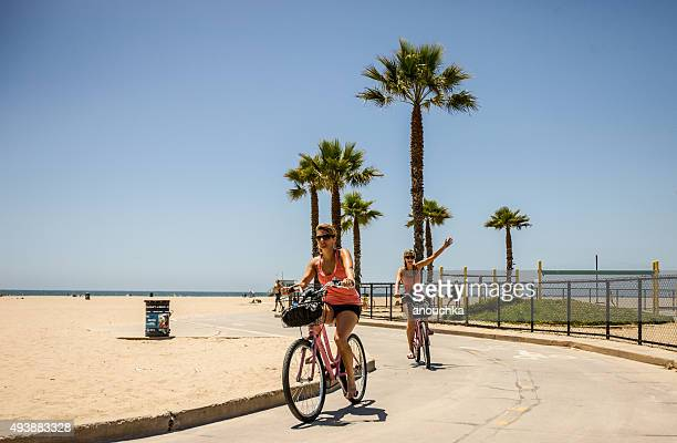 women cycling in santa monica - santa monica stock pictures, royalty-free photos & images