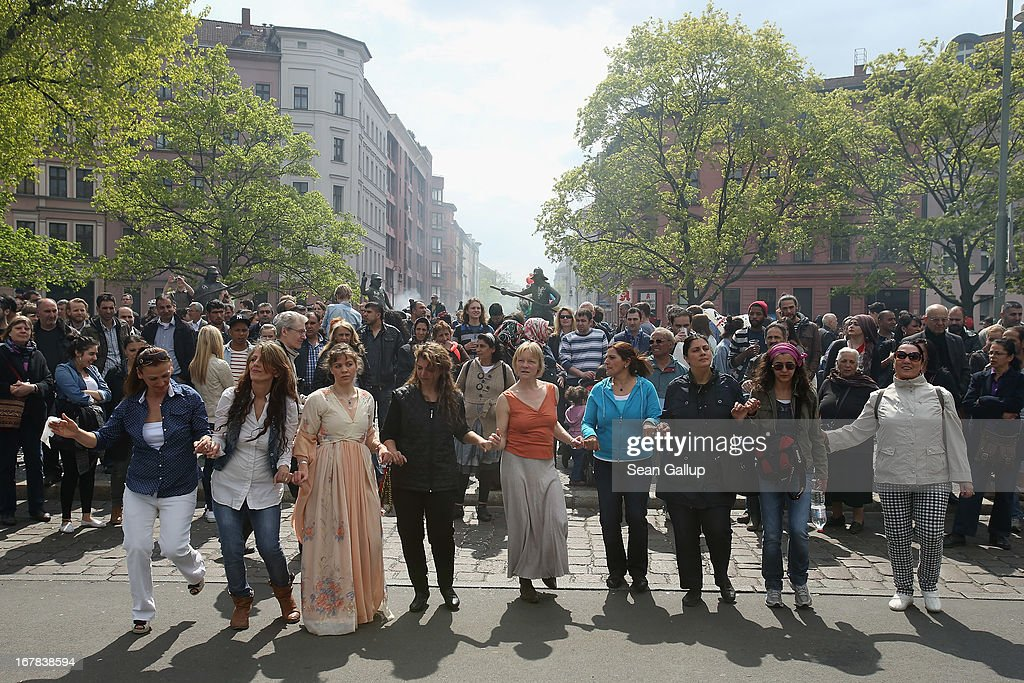 Women dance a traditional Kurdish dance at the MyFest street food and music fest in immigrant-heavy Kreuzberg district on May Day on May 1, 2013 in Berlin, Germany. May Day, the international day of labour, is a national holiday in Germany and observed with gatherings by labour unions and political parties. In some cities, including Hamburg and Berlin, the day often ends with violent clahes between police and mostly left-wing demonstrators.