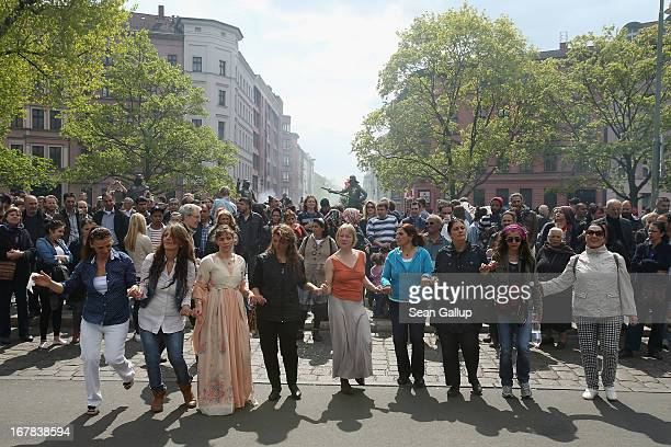 Women dance a traditional Kurdish dance at the MyFest street food and music fest in immigrantheavy Kreuzberg district on May Day on May 1 2013 in...