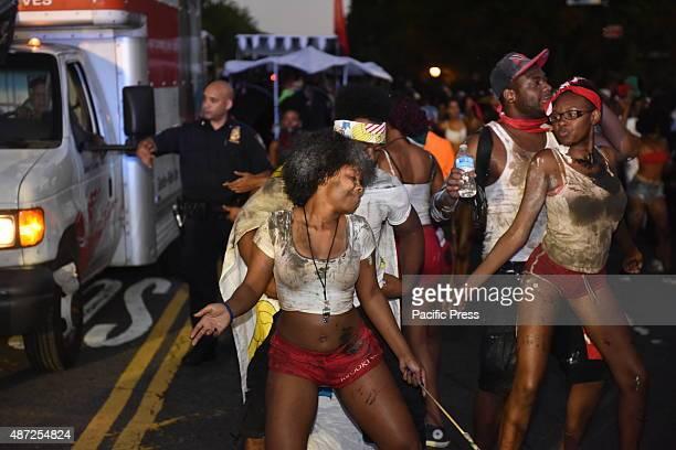 Women dance along Flatbush The annual J'ouvert celebration made its way along Flatbush Avenue from Grand Army Plaza