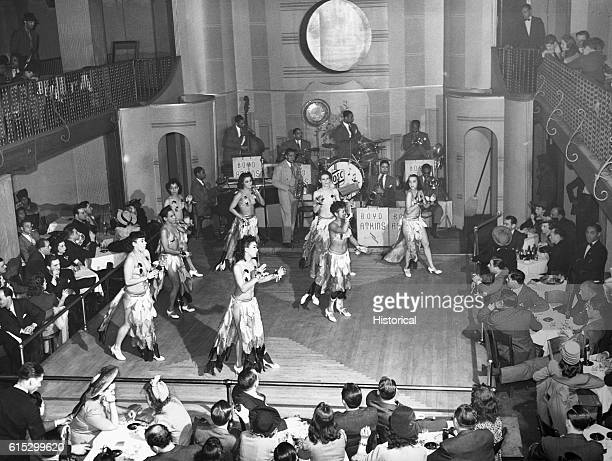 Women dance and a jazz band plays in a cabaret on Chicago's South Side April 1941