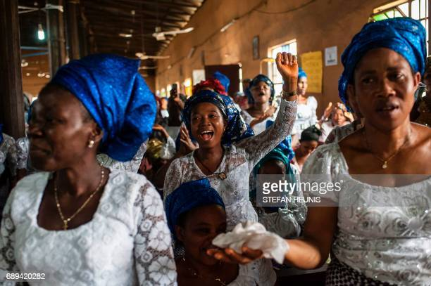 Women dance and sing during a service at the St Martin of Tours Catholic Church in the AbaSouth district in Aba on May 28 2017 The Nigerian civil...