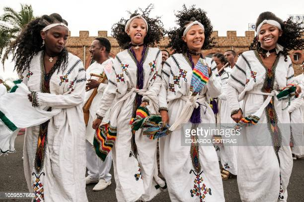 Women dance as they wait for the arrival of Eritrea's President at the airport in Gondar nothern Ethiopia on November 9 2018 The president of Somalia...