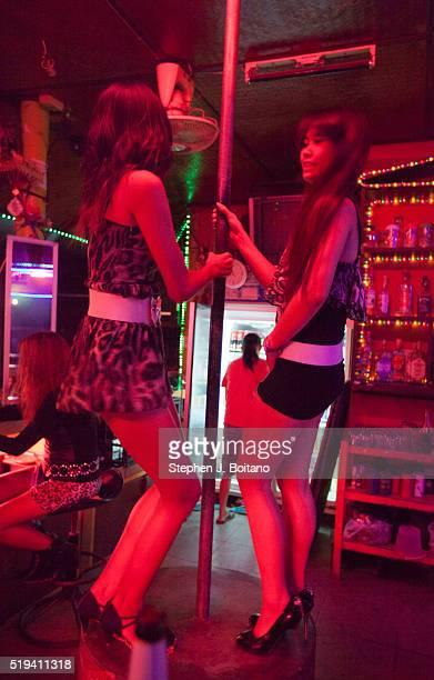Women dance at a bar girl bar in Lamai Beach on Ko Samui Island