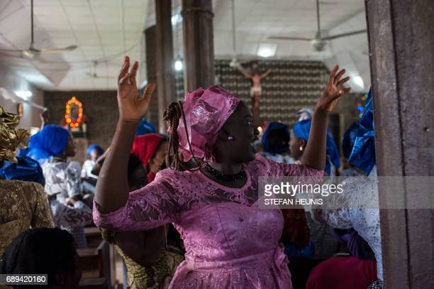 Women dance during a service at the St Martin of Tours Catholic Church in the AbaSouth district in Aba on May 28 2017 The Nigerian civil wars 50th...