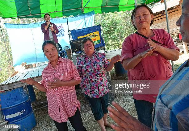 Women dance during ceremonies at the wedding of Kanokporn and Montri Thi in Ta Par Mok Thailand Thai Buddhist marriage ceremonies are generally...
