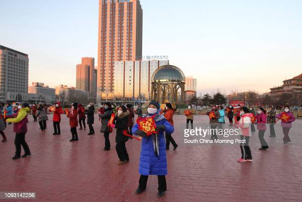 Women dance in a square in Baotou city Inner Mongolia on Saturday morning Nov 18 while the temperature drops to 12 degrees under zero The metro...