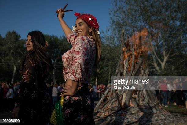 Women dance in front of a large bonfire during the Kakava Festival on May 5, 2018 in Edirne, Turkey. The annual Kakava spring festival celebrates the...