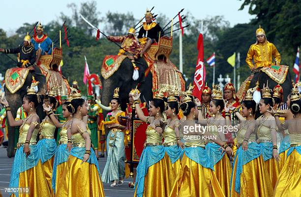 Women dance in front of elephants during a performance depicting an ancient war scene prior to a guard of honour ceremony as a part of the...