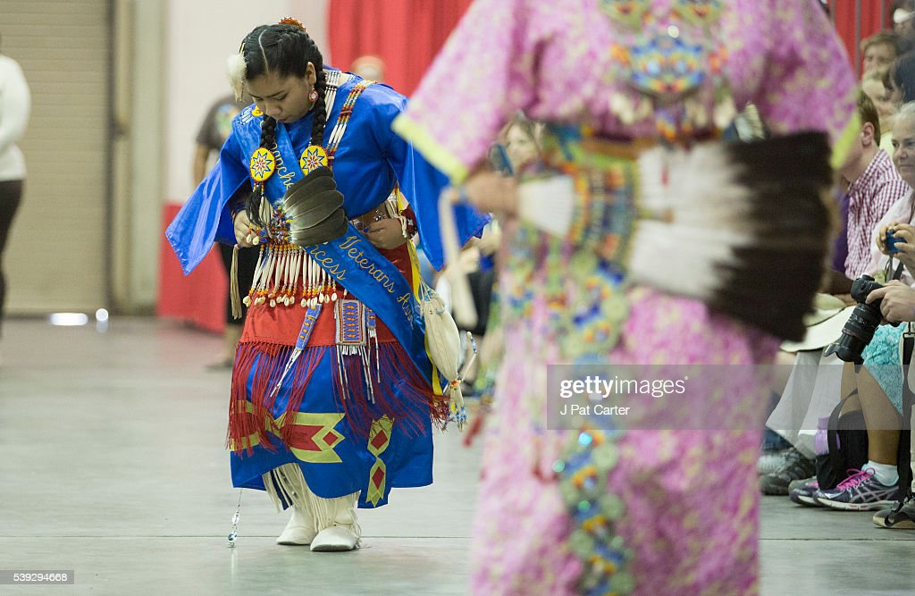 Women dance in the Southern Cloth Dance at the Red Earth Native American Festival, Friday, June 10, 2016 in Oklahoma City.