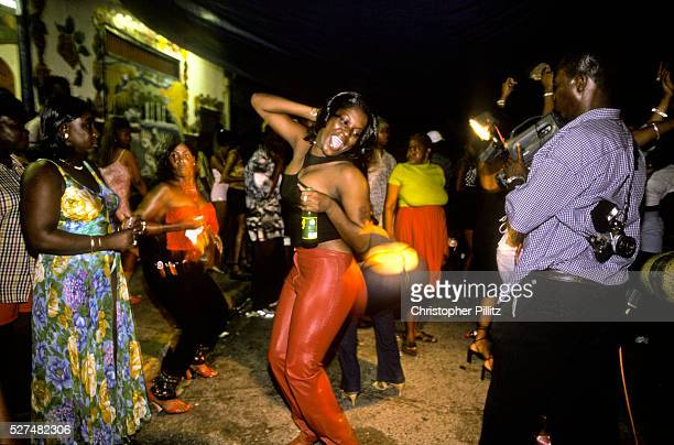 Women dance on the streets of Kingston to all night Dancehall A very sexualized style of dancing Jamaica