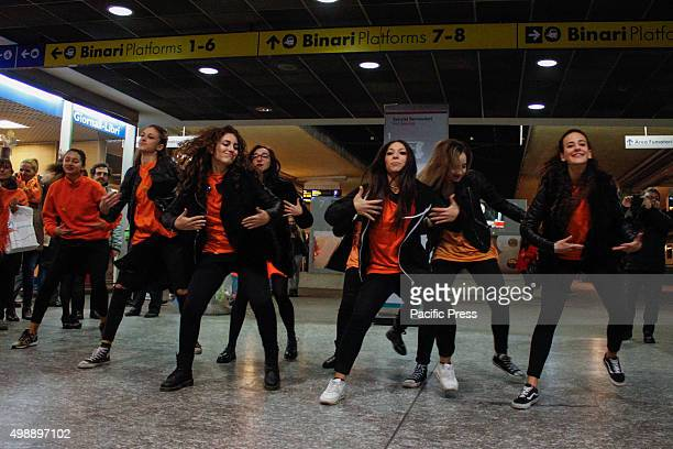 Women dance while wearing something orange a color chosen by ONU as a symbol of a future without violence against women gathered at the train station...