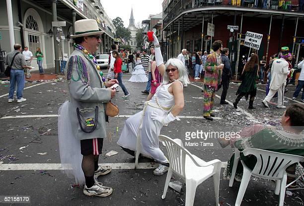 A women dances on Bourbon Street during Mardi Gras festivities February 8 2005 in New Orleans Louisiana Mardi Gras is the last carnival celebration...