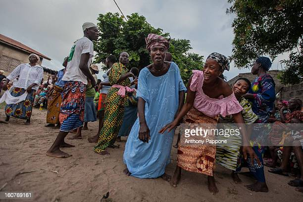Women dancing during voodoo ceremony in a grand popo village in benin, westafrica