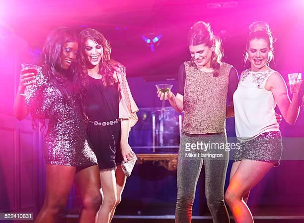 Women dancing in club