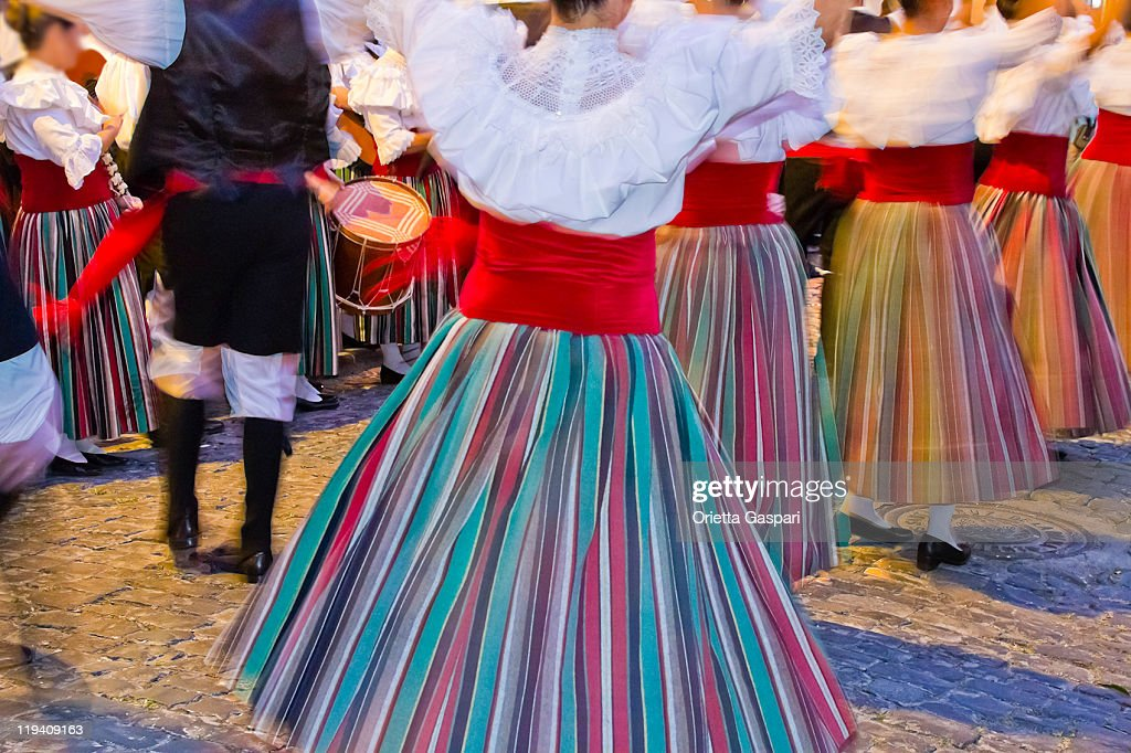 Women dancing in traditional clothing for a celebration : Stock Photo