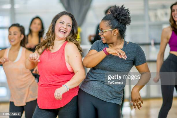 women dancing together - healthy lifestyle stock pictures, royalty-free photos & images
