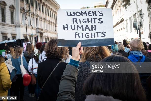 Women demonstrate against sexual harassment violence and US President Donald Trump in solidarity with American women during the Women's March along...
