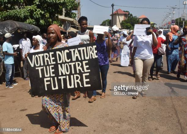 Women demonstrate to denounce the repression and call for justice for the people killed during mass antigovernment protests in Conakry on November 19...