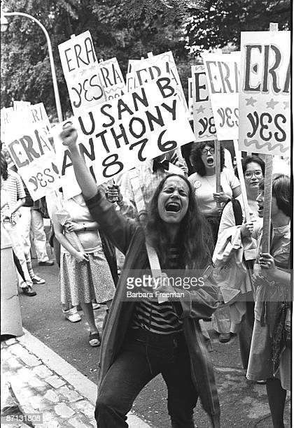 "Women demonstrating in favor of passage of the Equal Rights Amendment, Pittsburgh, PA, 1976. Women hold signs saying ""ERA YES"" while an impassioned..."