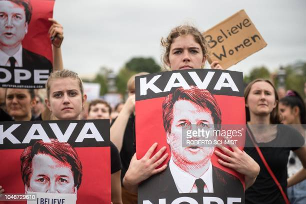 TOPSHOT Women demonstrators protest against the appointment of Supreme Court nominee Brett Kavanaugh at the US Capitol in Washington DC on October 6...