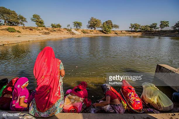Women devotees at bank of Gopi Talav near Dwarka ,Gujrat on
