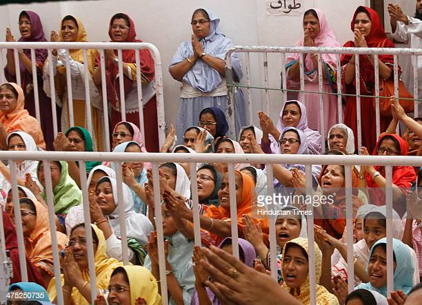 Women devotees belonging to the Dawoodi Bohra Muslim community take part in a final prayer after 40 days mourning period ended after Syedna Mohammed...