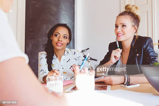 Women discussing in an office