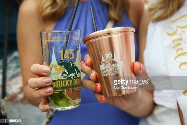 Women display mint julep drinks at the 145th running of the Kentucky Derby at Churchill Downs on May 4th 2019 in Louisville Kentucky