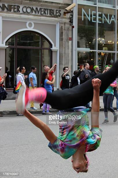 CONTENT] Women do backflips marching sporting tiedye and rainbows for the Boston Pride parade in early June cheering for LGBTQ rights