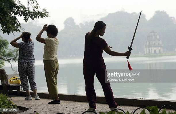 Women do their morning exercises near to Hoan Kiem lake in the very heart of Hanoi 14 November 2006 Vietnam has gone all out to host world leaders...