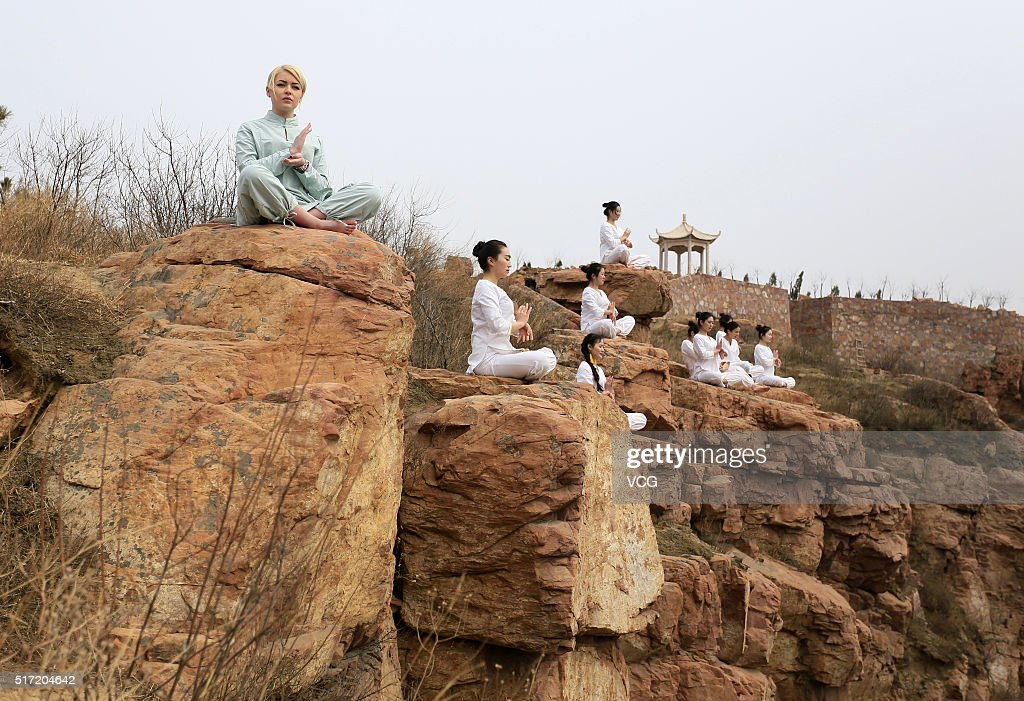 Women do yoga on the precipice of Mount Song on March 23, 2016 in Zhengzhou, Henan Province of China. Over 10 yoga enthusiasts practice on the precipice to experience stimulation in nature in Zhengzhou.
