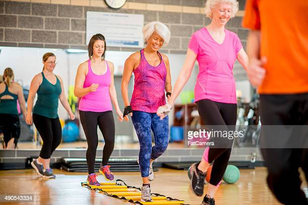 women doing a bootcamp class - circuit training stock photos and pictures