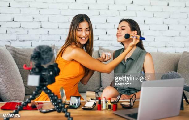 Women doing a make-up vlog