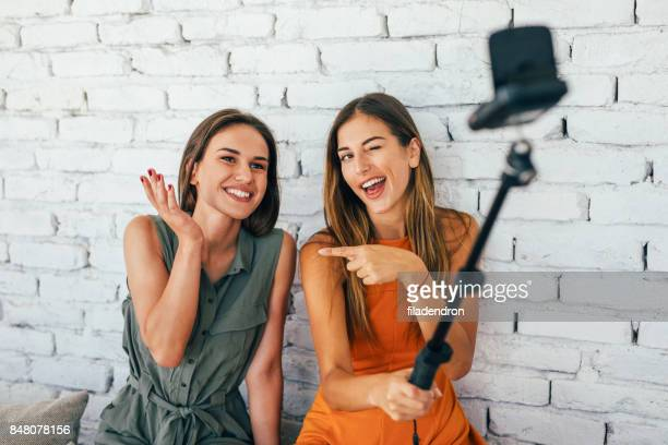 women doing a vlog - pointing at camera stock photos and pictures