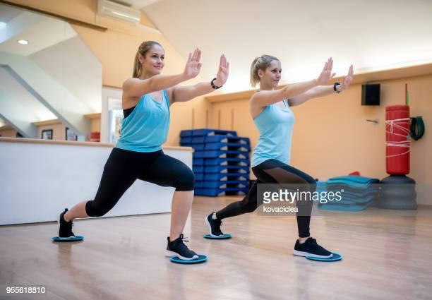 Women doing aerobics indoors