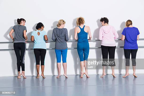 Women doing barre exercises