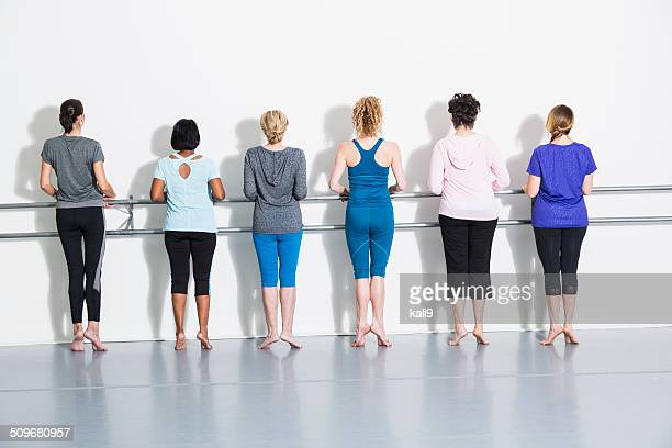 women doing barre exercises - barre class stock photos and pictures