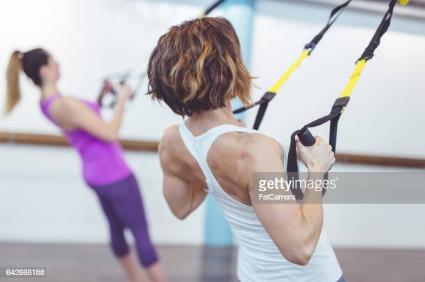 Women Doing Barre + TRX Workout