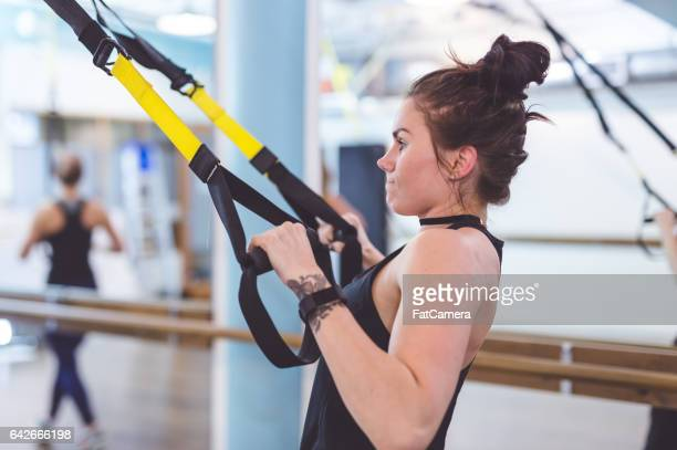 women doing barre + trx workout - barre class stock photos and pictures