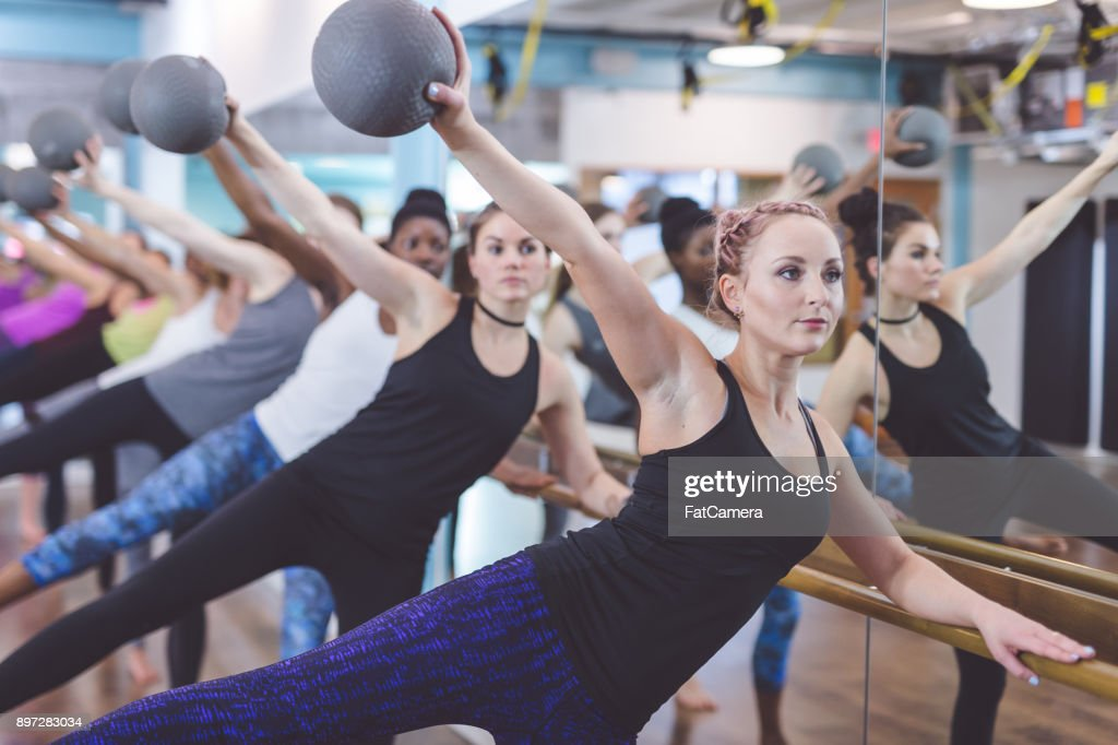 Women Doing Barre Workout Together at Modern Gym : Stock Photo