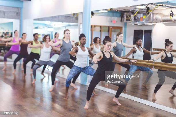 Women doing barre workout together