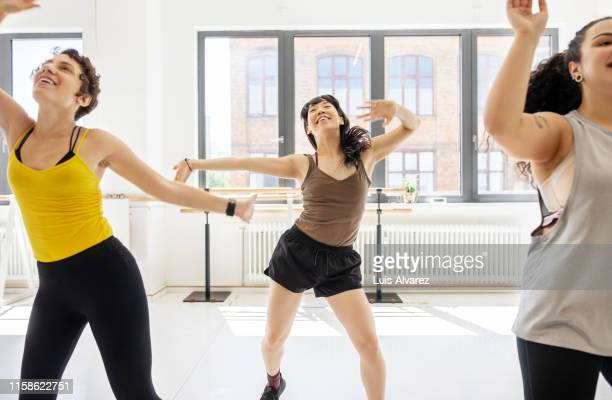 women doing fitness dance in class - chubby asian woman stock pictures, royalty-free photos & images