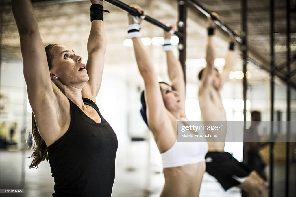 women doing gym/pullups : Stock Photo