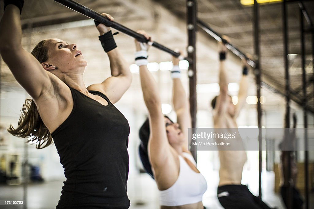 women doing gym/pullups : Stock Photo